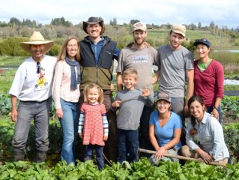 Elizabeth and Paul Kaiser (second and third from left) provide not only a healthy life for their family, but robust, year-round employment for their crew at Singing Frogs Farm (submitted photo).