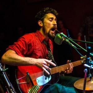 Matt Lorenz, performing as The Suitcase Junket; photo by Bill Foster.