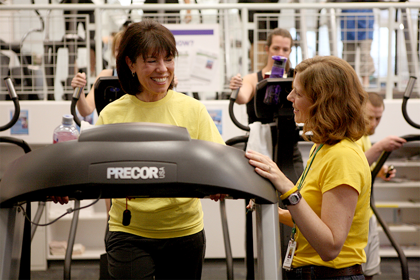 A YMCA trainer discusses fitness goals with a participant in LIVESTRONG at the YMCA; photo courtesy LIVESTRONG.
