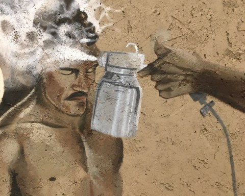 """Detail: """"Border Wash,"""" by Rafa Esparza; a Mexican immigrant laborers sprayed with DDT at processing center in Hildago, Texas - After Leonard Nadel, 1956, 2019; photo by Sara Farrell Okamura."""