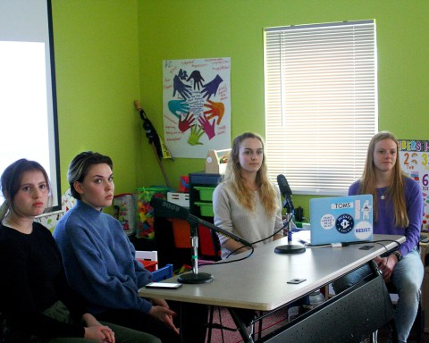 Members of the student group, R.E.V., at Mt. Greylock Regional School, Karen McComish, Sophie Jones, Maddy Art, and Ella Dudley speak at the Feburary 24 meeting of Greylock Together at the UNO Center in North Adams; photo by Jason Velázquez.