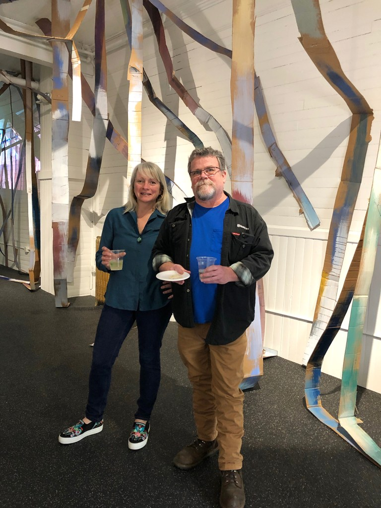 Gallery owner and artist Anna Farrington with writer James Kennedy.