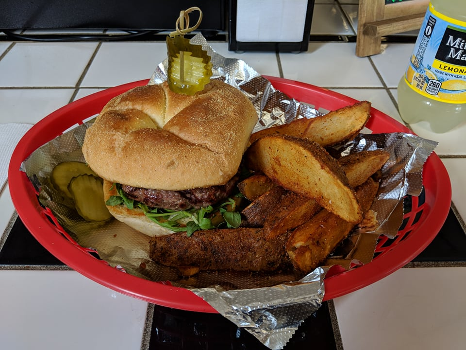 """The aptly named burger, """"The Balder,"""" bravely adorns itself with lettuce, roasted tomatoes, and onions, allowing it's brave flavors to shine through. Highly recommended side item? The hand cut wedge fries; photo by James Kennedy."""