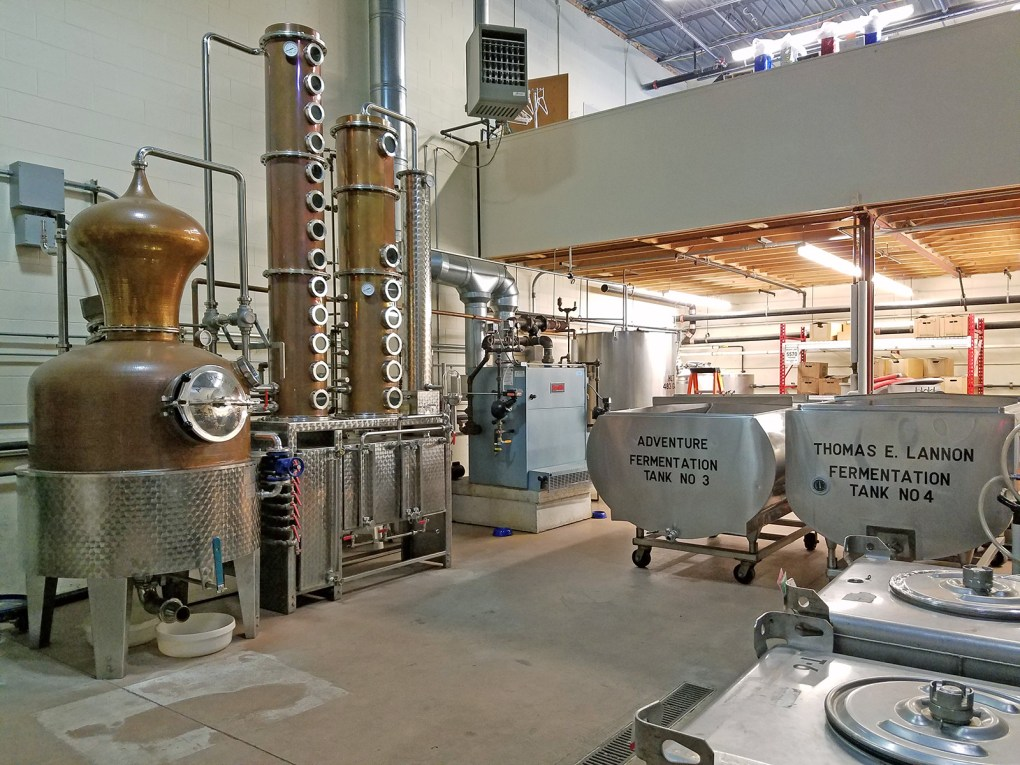 Photo of interior of distillery, showing vats and equipment: Ryan & Wood Distilleries offers an excellent behind-the-scenes tour filled with Prohibition history and lore; photo by Robin Catalano.
