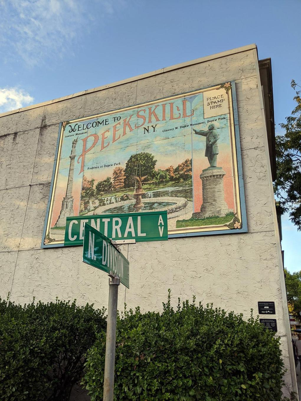 "Photo of a large mural on the side of a building with the words, ""Welcome to Peekskill,"" The town was not the actual filming location of '80s sitcom The Facts of Life, which was set in a fictitious version of the city; photo by Robin Catalano."