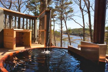 Beautiful Tree House with a Wood-Fired Cedar Hot Tub Overlooking Back River, Maine; submitted image.
