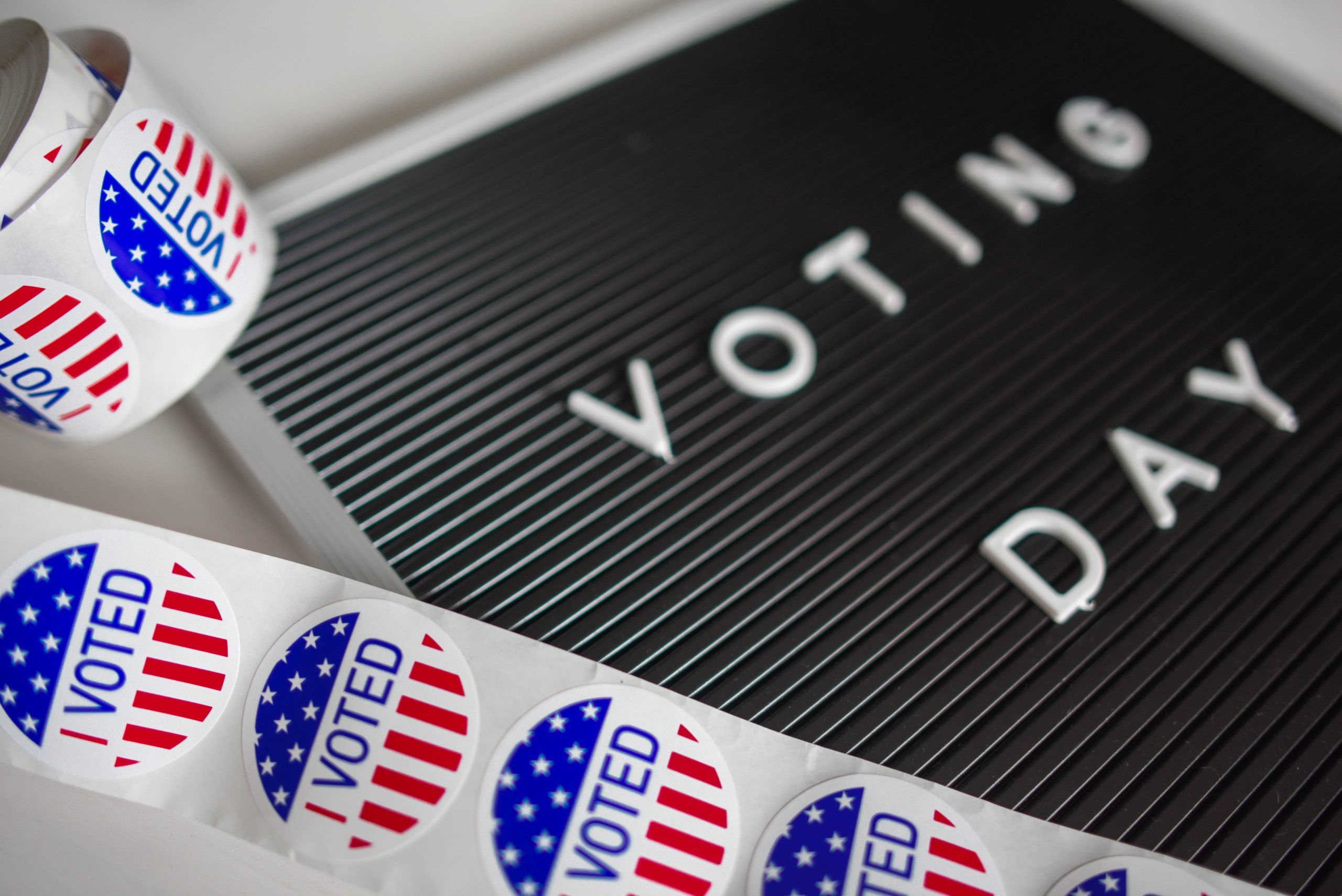 Letterboard spelling out the words Voting Day, along with stickers that say I voted