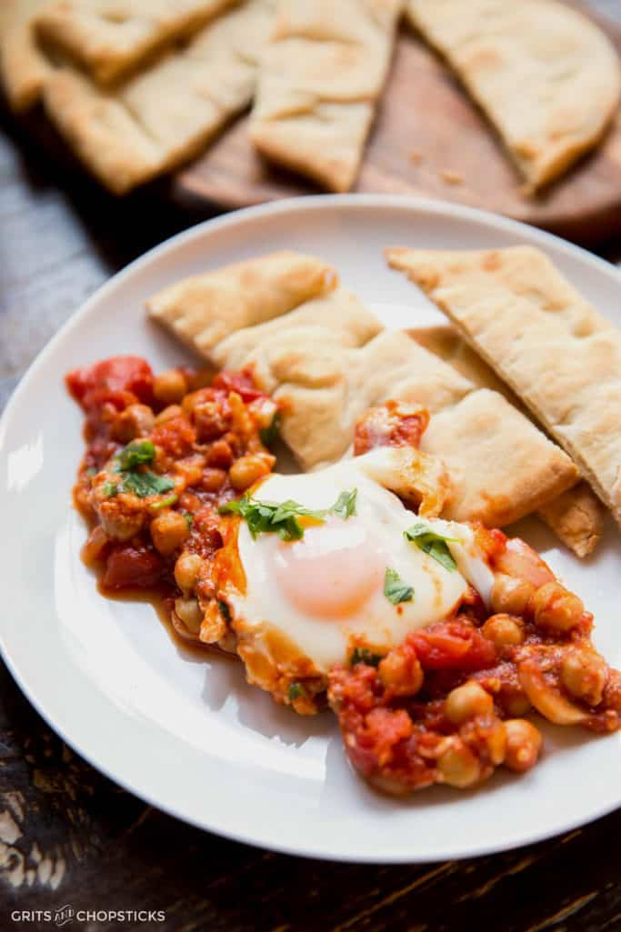 This recipe calls for poached eggs to simmer in a rich tomato sauce with feta, eggplant and chickpeas. Also known as shakshuka, it's a perfect healthy meal for any time of the day (breakfast included)!