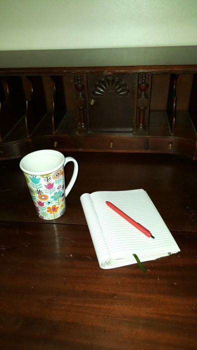 Coffee Cup and notepad and pen on desk