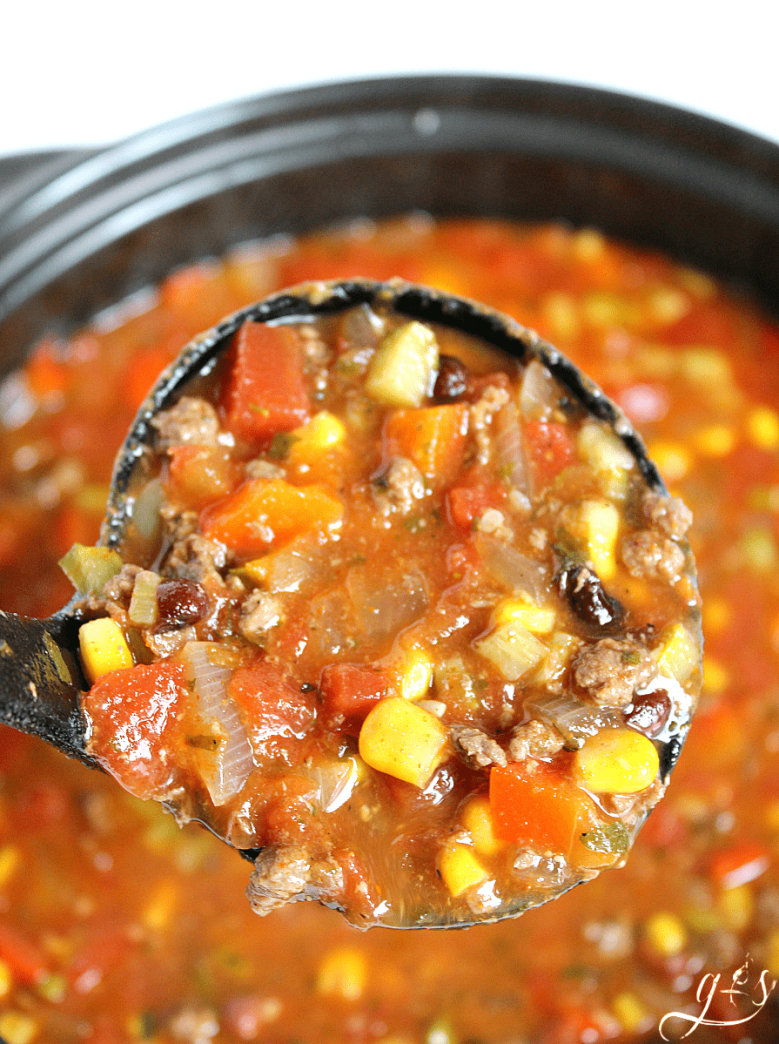 Simply the BEST Taco Soup - an easy, healthy, & gluten free stove top meal that uses ground turkey (bison, beef, or venison) along with tons of clean eating vegetables and pantry items like canned beans. The option to use homemade ranch and taco seasonings take this dinner to a whole new level. This quick, skinny, and low carb recipe is simple to prepare and has been a family favorite of ours for years!