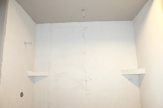 Shower walls with measurements for installing tile.