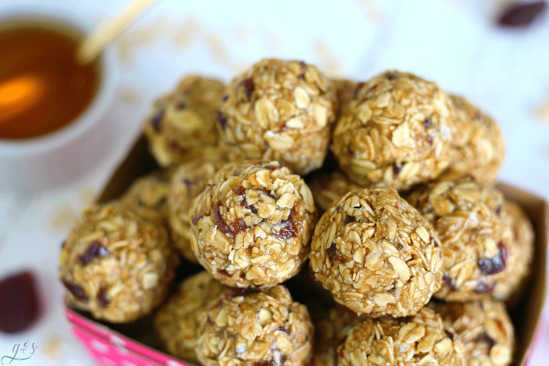 Up close shot of an energy bite recipe that is nut free and only uses four ingredients- oatmeal, Sunbutter, honey, and dried strawberries.