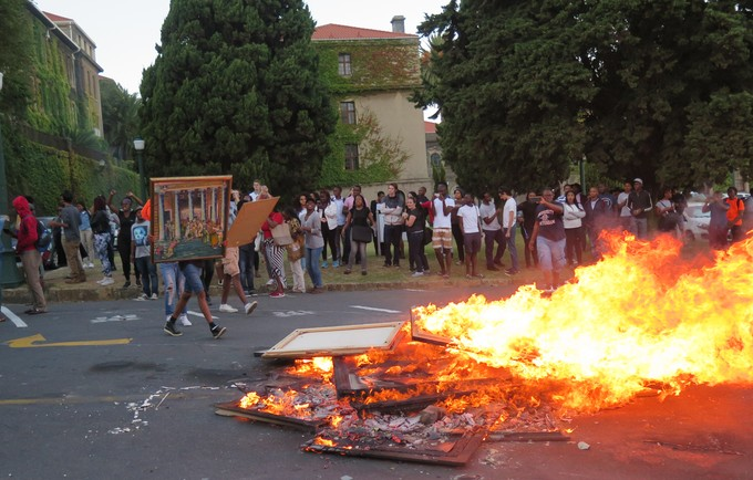 Photo of people burning art