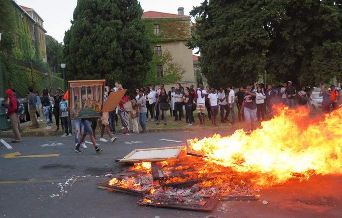 Photo of people burning art