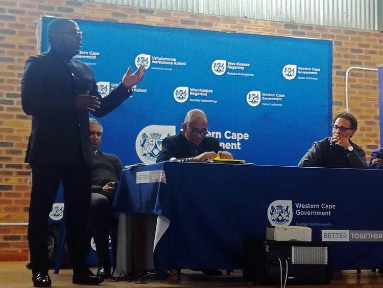 Photo of man addressing meeting
