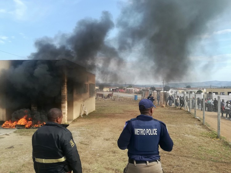 Photo of tyres burning outside an office building