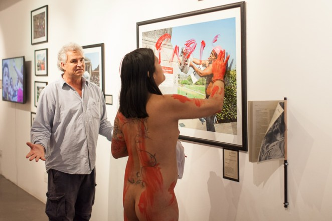 Photo of art being vandalised by a naked person