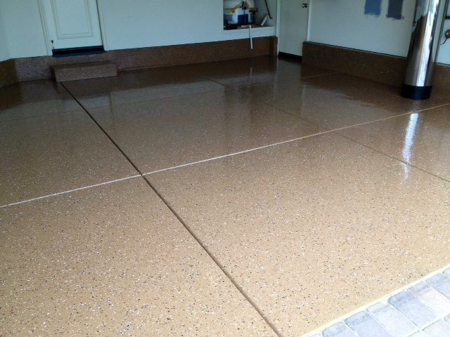tired of the plain and easy to stain garage floor looking to paint the garage also referred to as epoxy coating grout and stone services is a