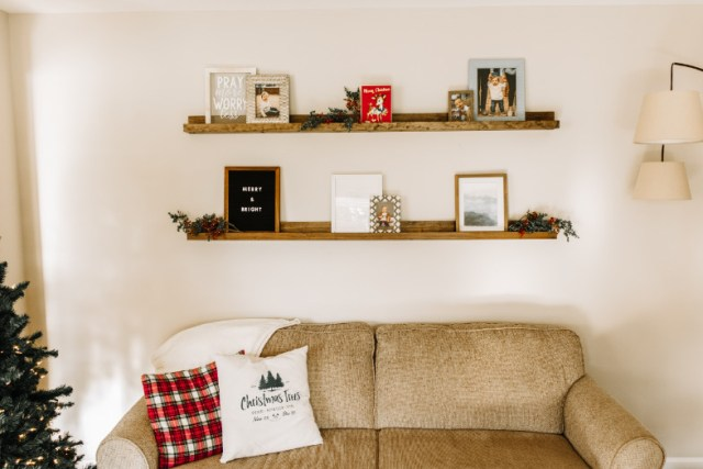 DIY picture frame ledge shelf decorated on wall above couch