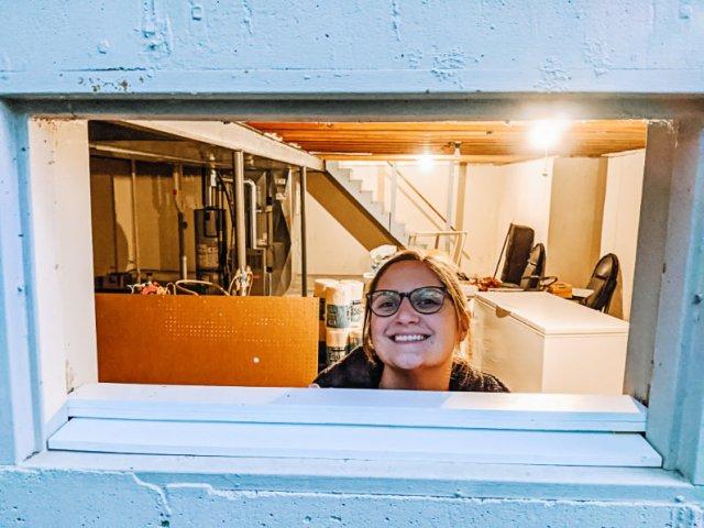Megan through basement casement window