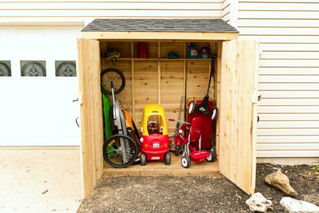 Mini shed with stored outdoor toys