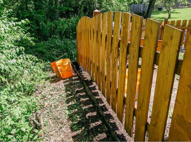 Mulching under our fence line, wooded side with terrace board