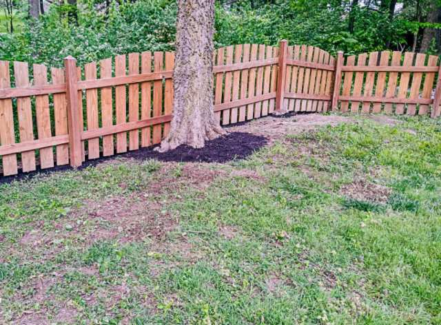 Mulching under our fence line, after