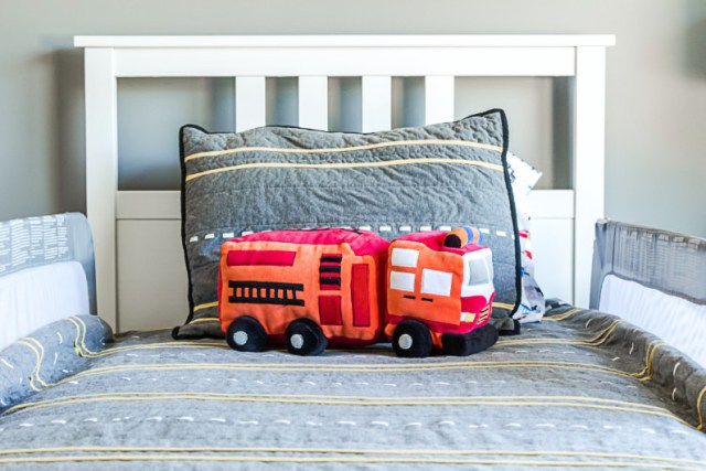 Firetruck pillow from Target for transportation themed room