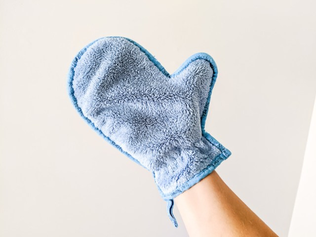 Norwex Dusting Mitt in use