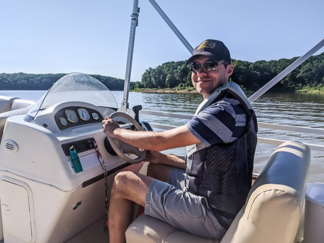 Driving pontoon boat with certification on lake
