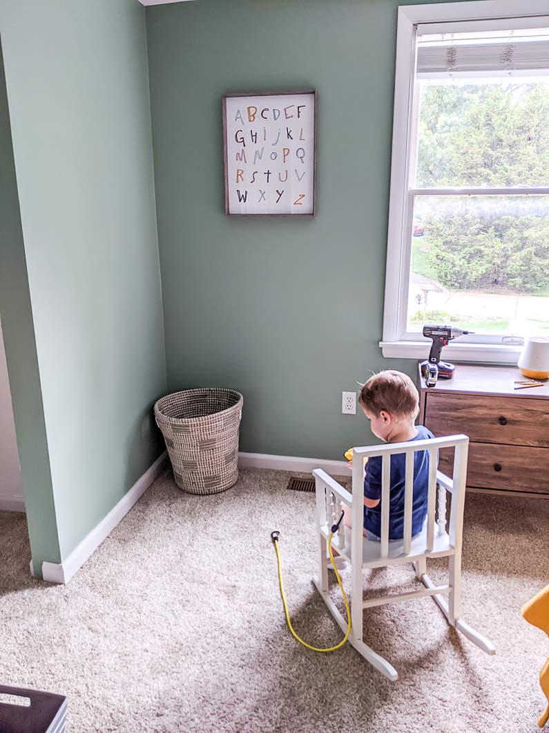 C sitting in nursery rocking chair