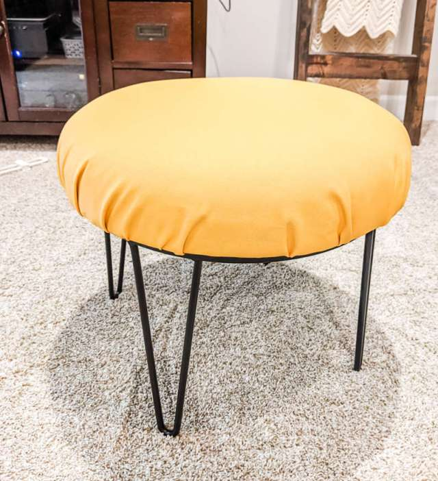 Glider ottoman from C's nursery reupholstered with mineral yellow canvas