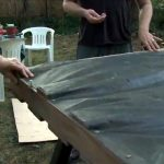 Attach landscape fabric and thin plywood to the back