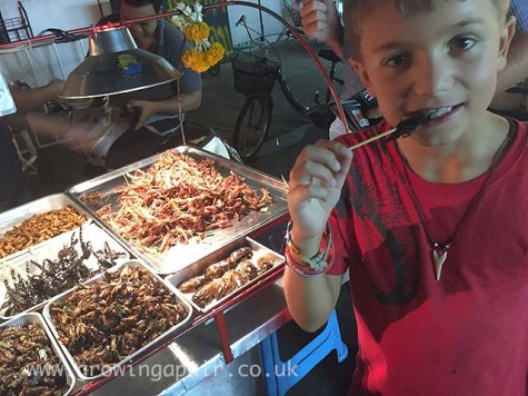 Eating deep fried scorpions in Bangkok, Thailand