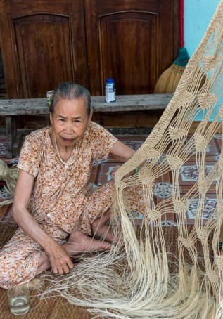 Old lady weaving