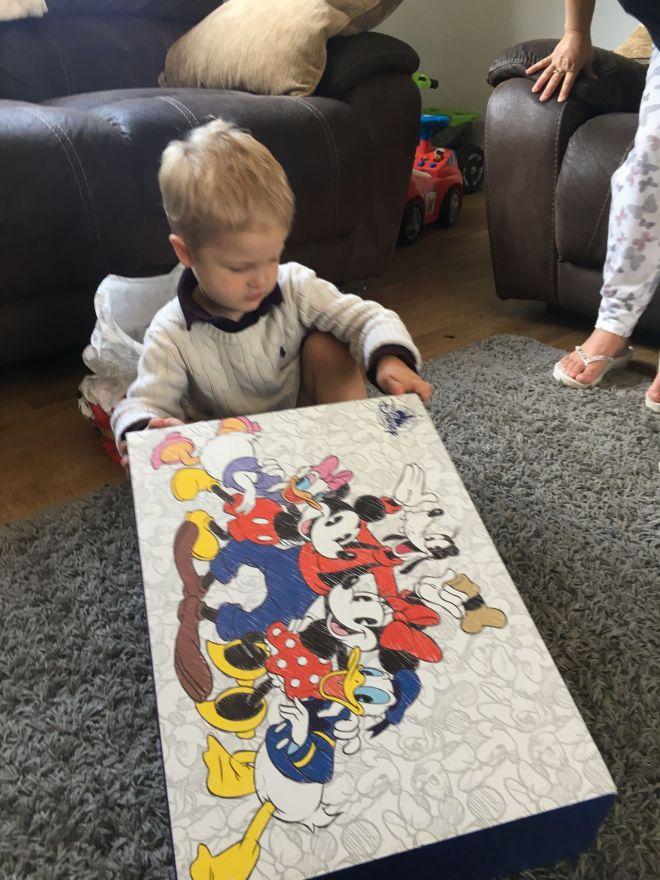 opening his birthday presents