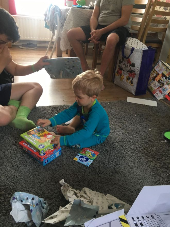 opening his birthday presents