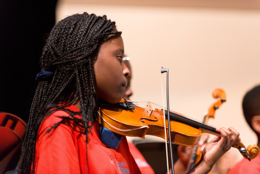 Photo of young black female violinist