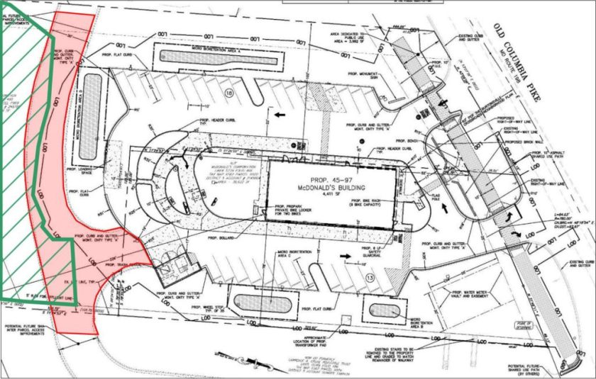 Annotated site plan showing location of future rear entrance (red) on top of forest conservation easement (green).