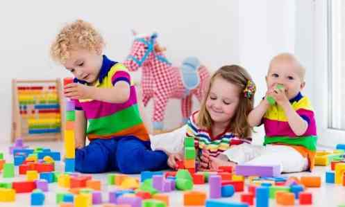 big family siblings play with blocks together