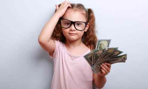 girl from big family holding money