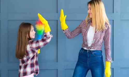 mother and daughter of big family cleaning and giving high fives