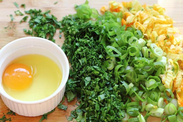 chopped squash blossom, parsley and spring onion