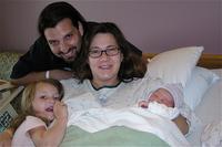 Newborn Kira and family