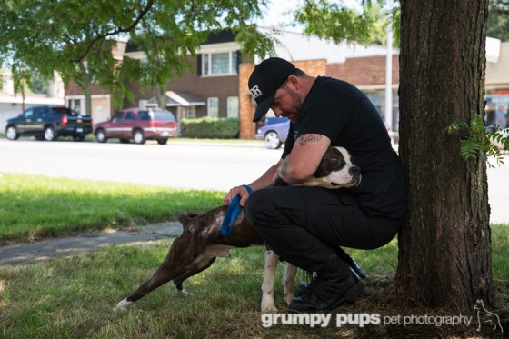Dante Dasaro of Detroit Dog Rescue hugs Dante, a rescue named after him. grumpy pups pet photography