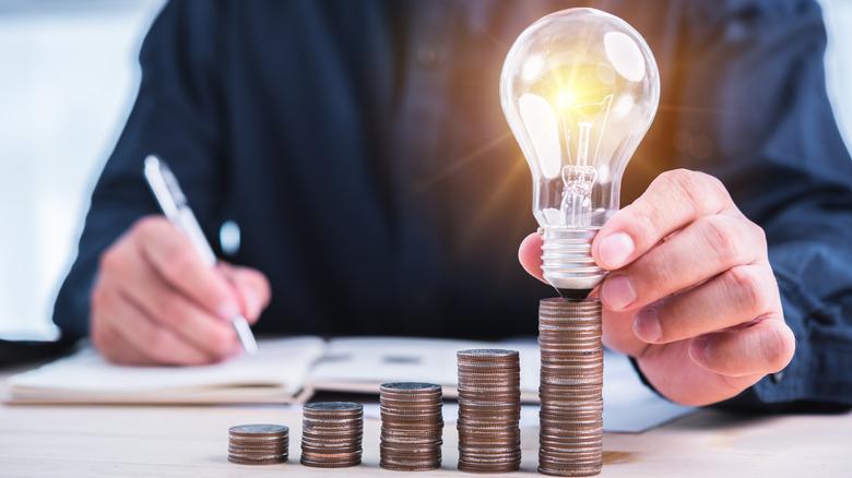 Lightbulb on stack of coins