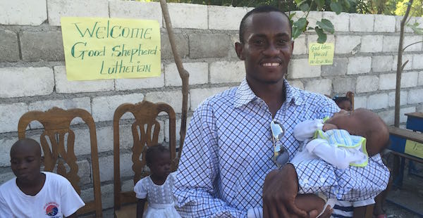 Pastor Nicolas with newborn baby recently brought to orphanage.  Mother had died in childbirth.