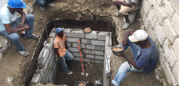 Digging latrine in Haiti