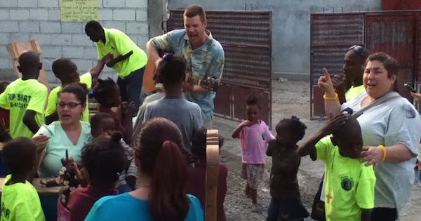 Singing with guitar at orphanage