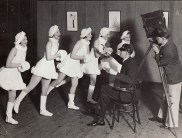 GSA Kinecraft Society, making a film of the cabaret at their first dance, showing photographer, director and 5 ice skaters (Archive reference: GSAA/P/1/142)